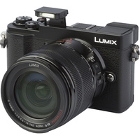 Panasonic Lumix DC-GX9 + Lumix G Vario 14-140 mm Power OIS 								- Vue principale