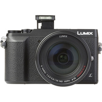 Panasonic Lumix DMC-GX80 + Lumix G Vario 14-140 mm Power OIS - Vue de face sans objectif