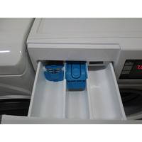 Bosch WVH28461FF(*18*) - Accessoire spécifique pour le dosage de la lessive liquide (en bleu à gauche).