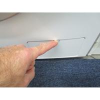 Thomson THWD16107(*12*) - Ouverture de la trappe du filtre de vidange