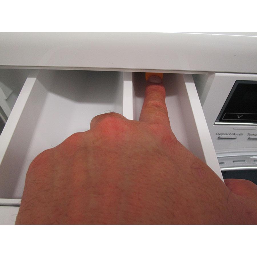 Miele WTF105WCS - Bouton de retrait du bac à produits