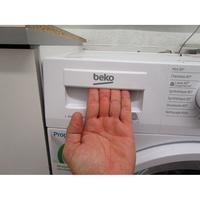 Beko DWTV6621XWOW - Ouverture du tiroir à détergents