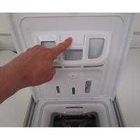 Bosch WOT24257FF - Bouton de retrait du bac à produits