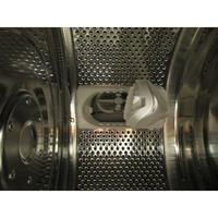 Curtiss PTL1055E - Aube du tambour donnant accès au filtre de vidange intégré dans la cuve