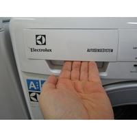 Electrolux EWF1404RA - Ouverture du tiroir à détergents