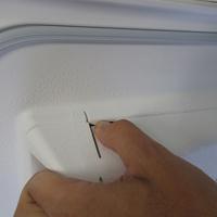 Far (Conforama) LT5510 - Bouton de retrait du bac à produits
