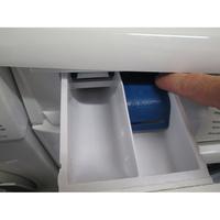 Faure FWF7125PW - Bouton de retrait du bac à produits
