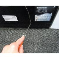 Hotpoint FMF923K EU.C - Outil nécessaire pour accéder au filtre de vidange