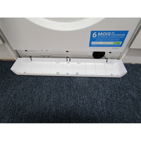 Indesit XWA71452WFR - Ouverture de la plinthe masquant le filtre de vidange