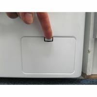 LG F94J53WHS 6 Motion Direct Drive - Ouverture de la trappe du filtre de vidange