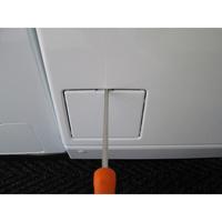 Miele W194 - Outil nécessaire pour accéder au filtre de vidange