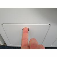 Miele WCR860WPS - Ouverture de la trappe du filtre de vidange