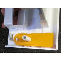 Miele WDA105 - Outil d'ouverture de la trappe du filtre de vidange (outil rangé dans le bac à produits)