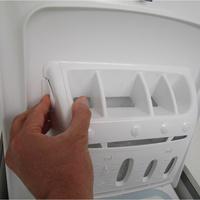 Thomson (Darty) TTL 6513 - Bouton de retrait du bac à produits