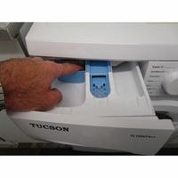 Tucson TL1006FA++ - Bouton de retrait du bac à produits
