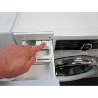 Whirlpool FSCR80421  - Bouton de retrait du bac à produits