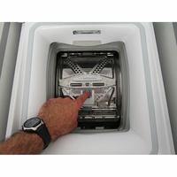 Whirlpool TDLR65330 - Bouton d'ouverture des portillons