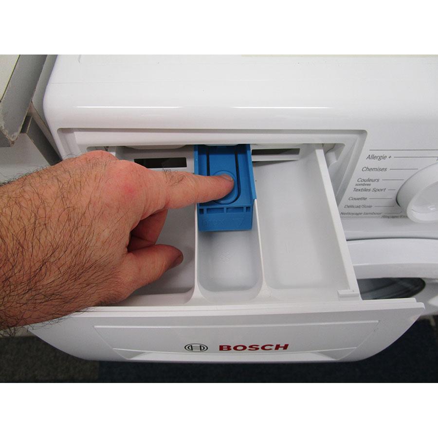 Bosch WAN24200FF - Bouton de retrait du bac à produits
