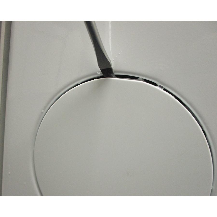 Indesit BTWS62300FRN - Outil nécessaire pour accéder au filtre de vidange