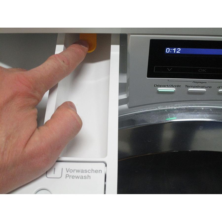 Miele WKF121 - Bouton de retrait du bac à produits