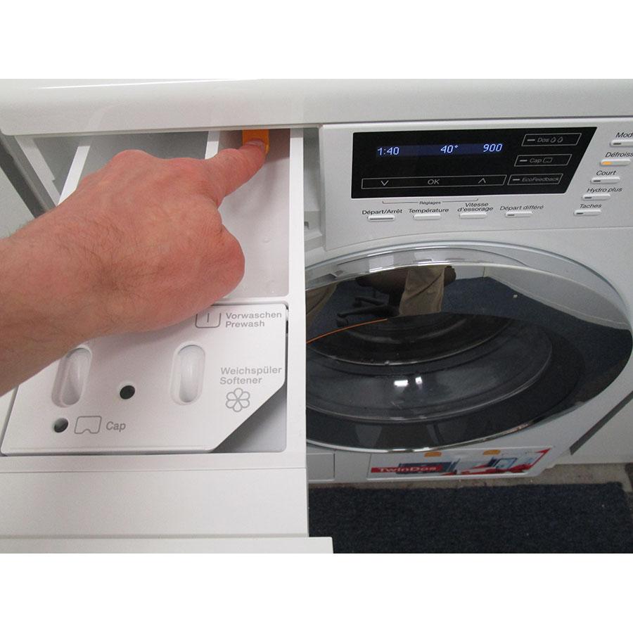 Miele WKH122WPS - Bouton de retrait du bac à produits