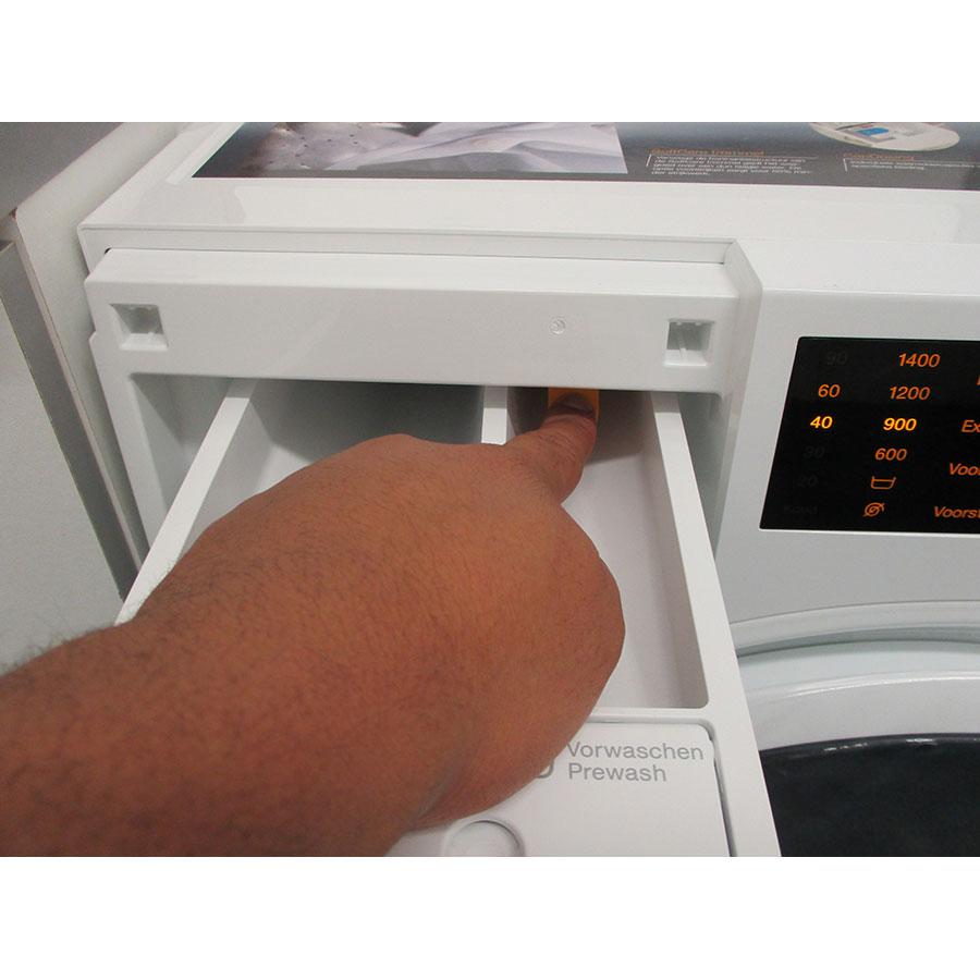 Miele WWD120 - Bouton de retrait du bac à produits