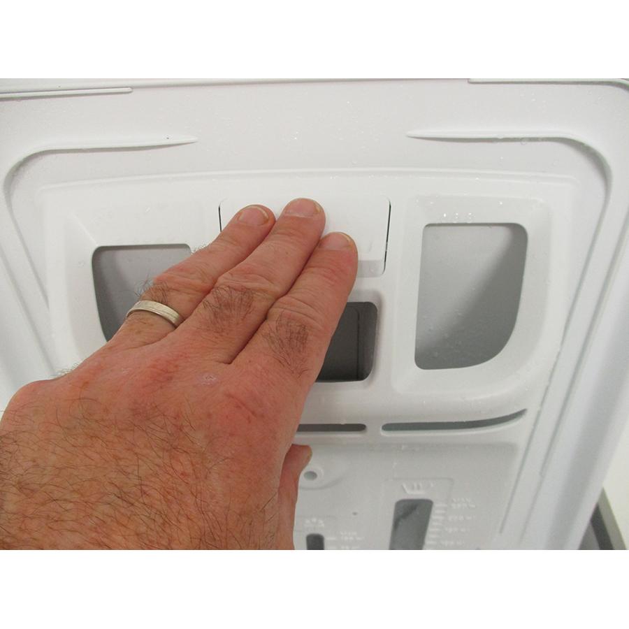 Whirlpool TDLRB6242BSFR/N - Bouton de retrait du bac à produits