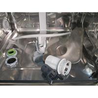 Indesit DFP 28B16 FR - Réservoir à sel ouvert et retrait du filtre
